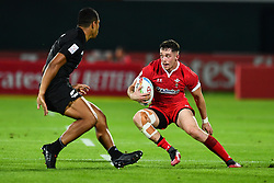 Joe Goodchild of Wales in action<br /> <br /> Photographer Craig Thomas/Replay Images<br /> <br /> World Rugby HSBC World Sevens Series - Day 1 - Thursday 5rd December 2019 - Sevens Stadium - Dubai<br /> <br /> World Copyright © Replay Images . All rights reserved. info@replayimages.co.uk - http://replayimages.co.uk