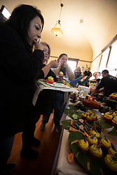 Unidentified judges sample an entry in the recipe contest at the 22nd annual Spam Festival, Sunday, Feb. 16, 2019, in Isleton, Calif. Spam lovers competed for prizes by presenting their favorite Spam-infused foods, or entering the Spam-eating and Spam-toss contests. (Photo by D. Ross Cameron)