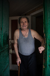 Ivan Vorobyeva, 74, greets the MSF home visits medical team at the front door of his apartment in Debaltsevo.