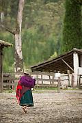 Local walking past Hacienda Zuleta, Ecuador, South America.