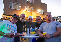 Gary Clapp, Dennis H, Big T, AJ Paula and Andy Love having a beer Saturday night during Biketemberfest at Weirs Beach.  (Karen Bobotas/for the Laconia Daily Sun)