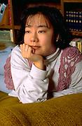 Korean American youth coordinator age 27 deep in thought.  St Paul  Minnesota USA