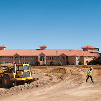 102813       Brian Leddy<br /> A construction worker works at the scene of what will soon be a Hilton Hotel near Applebee's on Maloney Avenue Monday.