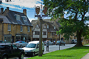 Tourist taking photographs in the quaint town of Chipping Campden, The Cotswolds, Gloucestershire
