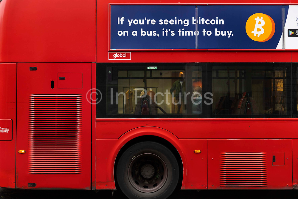 Advert for Bitcoin on a bus in the capitals West End during the third lockdown of the Coronavirus pandemic, on 3rd March 2021, in London, United Kingdom. The cryptocurrency hit a new record high of $42,000 late last week, only to plunge by more than 20% over the weekend. Now at around $34,500, bitcoin has still rocketed since October, when it cost $11,000.