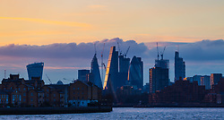 The skyscrapers of The City reflect the setting sun as the FTSE and European markets follow US and Asian markets lower on Tuesday as investors continued to dump shares. London, February 06 2018.