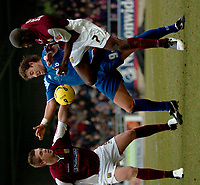 Photo: Ian Hebden.<br />Northampton Town v Rushden & Diamonds. Coca Cola League 2. 04/02/2006.<br />Northampton's Luke Chambers (L) Rushden's Drewe Broughton (C) and Ian Taylor (R) scrap for the ball.