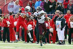 06 October 2012:  Tyrone Walker works on grabbing a pass from Matt Brown as he is pestered by Courtney Richmond during an NCAA football game between the Southern Illinois Salukis and the Illinois State Redbirds at Hancock Stadium in Normal IL