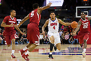 DALLAS, TX - NOVEMBER 25: Keith Frazier #4 of the SMU Mustangs brings the ball up court against the Arkansas Razorbacks on November 25, 2014 at Moody Coliseum in Dallas, Texas.  (Photo by Cooper Neill/Getty Images) *** Local Caption *** Keith Frazier