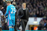 Swansea City Manager Garry Monk looks on as Goalkeeper Gerhard Tremmel is being subbed on instead of Goalkeeper Lukasz Fabianski of Swansea City who was sent off. Barclays Premier league match, West Ham Utd v Swansea city at the Boleyn ground, Upton Park in London on Sunday 7th December 2014.<br /> pic by John Patrick Fletcher, Andrew Orchard sports photography.