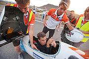 Sebastiaan Bowier bij de finish met de VeloX3 van het Human Power Team Delft en Amsterdam tijdens de tweede westrijddag van de WHPSC. In Battle Mountain (Nevada) wordt ieder jaar de World Human Powered Speed Challenge gehouden. Tijdens deze wedstrijd wordt geprobeerd zo hard mogelijk te fietsen op pure menskracht. Ze halen snelheden tot 133 km/h. De deelnemers bestaan zowel uit teams van universiteiten als uit hobbyisten. Met de gestroomlijnde fietsen willen ze laten zien wat mogelijk is met menskracht. De speciale ligfietsen kunnen gezien worden als de Formule 1 van het fietsen. De kennis die wordt opgedaan wordt ook gebruikt om duurzaam vervoer verder te ontwikkelen.<br /> <br /> Sebastiaan Bowier arrives with the VeloX3 of the Human Power Team Delft and Amsterdam at the second day at the WHPSC. In Battle Mountain (Nevada) each year the World Human Powered Speed Challenge is held. During this race they try to ride on pure manpower as hard as possible. Speeds up to 133 km/h are reached. The participants consist of both teams from universities and from hobbyists. With the sleek bikes they want to show what is possible with human power. The special recumbent bicycles can be seen as the Formula 1 of the bicycle. The knowledge gained is also used to develop sustainable transport.