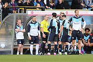 Referee Brendan Malone speaks to the Wycombe players after they complain to the Referee for allowing Lyle Taylor of AFC Wimbledon goal to stand.  Skybet football league two match, Wycombe Wanderers  v AFC Wimbledon at Adams Park  in High Wycombe, Buckinghamshire on Saturday 2nd April 2016.<br /> pic by John Patrick Fletcher, Andrew Orchard sports photography.