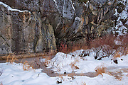 Frozen creek by rock cliff. Ingulf Road<br />Whiteshell Provincial Park<br />Manitoba<br />Canada