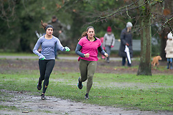 © Licensed to London News Pictures 16/01/2021.        Greenwich, UK. Two women running round the park. The snowy weather turns to rain this afternoon with people getting out of the house from Coronavirus lockdown to exercise in Greenwich Park, London. Photo credit:Grant Falvey/LNP