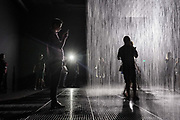 Visitors experience the Rain Room by artists Random International at the Yuz Museum,  located in the up and coming West Bund district of Shanghai,  China on 09 September 2015.