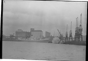 08/03/1964<br /> 03/08/1964<br /> 08 March 1964<br /> Views at the port of Dublin. Note cranes and Bollards Mill silo in background.