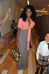 Singer SINITTA at a party to celebrate the opening of Purple Dragon - A new family members club at Grosvenor Waterside, 30 Gatliff Road, London SW1 on 29th September 2011.