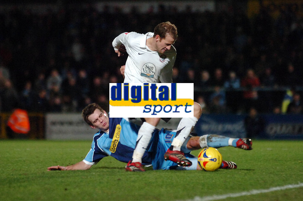 Photo: Kevin Poolman.<br />Wycombe Wanderers v Hereford United. Coca Cola League 2. 01/01/2007. Trent McClenahan of Hereford is tackled by Wycombe's Matt Bloomfield.