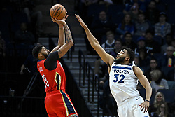 November 14, 2018 - Minneapolis, MN, USA - The Minnesota Timberwolves' Karl-Anthony Towns (32) pressures a 3-point attempt by the New Orleans Pelicans' Anthony Davis (23) in the first half on Wednesday, Nov. 14, 2018, at Target Center in Minneapolis. (Credit Image: © Aaron Lavinsky/Minneapolis Star Tribune/TNS via ZUMA Wire)