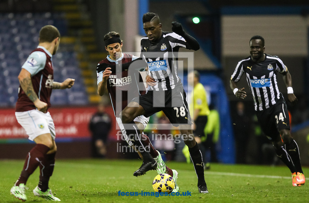 Sammy Ameobi of Newcastle United and George Boyd of Burnley compete for the ball during the Barclays Premier League match at Turf Moor, Burnley<br /> Picture by Daniel Chesterton/Focus Images Ltd +44 7966 018899<br /> 02/12/2014