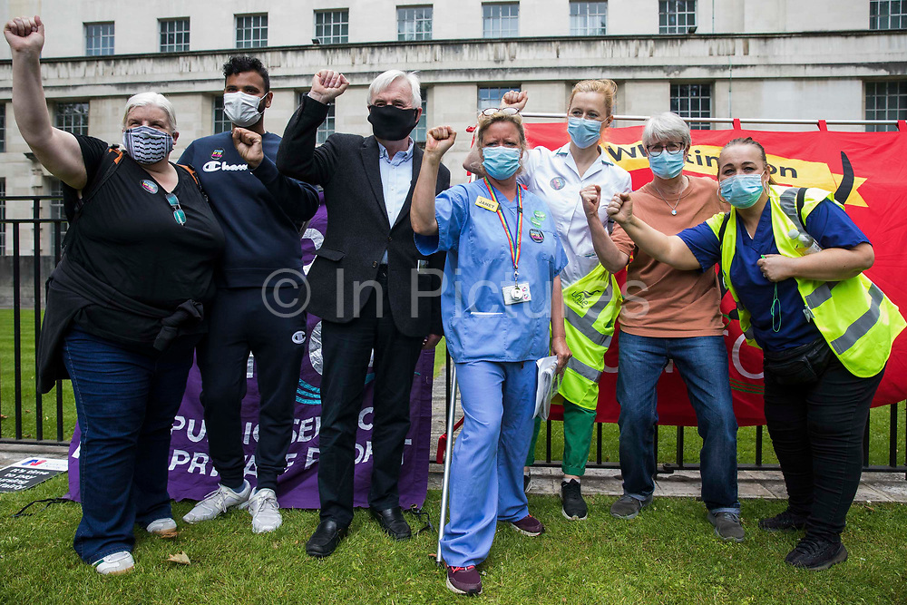 John McDonnell c, Labour MP for Hayes and Harlington, joins NHS workers and supporters at a protest rally opposite Downing Street as part of a national day of action to mark the 73rd birthday of the National Health Service on 3rd July 2021 in London, United Kingdom. The protesters called for fair pay for NHS workers, for better funding of the NHS and for an end to privatisation measures affecting the NHS.
