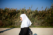 A nun is returning from the Jordan River during the day of the Epiphany at the 'Qasr el Yahud' baptism site in the Jordan River Valley, near the West Bank city of Jerico. The Epiphany celebrates the baptism of Jesus, which is belived to be in this same location.
