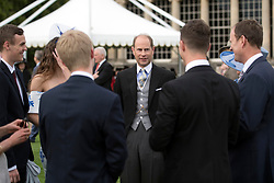 The Earl of Wessex talks to guests during a garden party at Buckingham Palace in London.