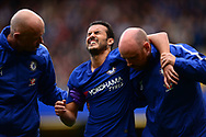 Pedro of Chelsea is carried off the pitch injured. Premier league match, Chelsea v Arsenal at Stamford Bridge in London on Sunday 17th September 2017.<br /> pic by Andrew Orchard sports photography.