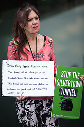 A Green Party supporter takes part in a protest by environmental activists and local residents against the construction of the Silvertown Tunnel on 5th June 2021 in London, United Kingdom. Campaigners opposed to the controversial new £2bn road link across the River Thames from the Tidal Basin Roundabout in Silvertown to Greenwich Peninsula argue that it is incompatible with the UK's climate change commitments because it will attract more traffic and so also increased congestion and air pollution to London's most polluted borough.