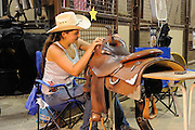 Youth from around the world converged on Oklahoma City for the American Quarter Horse Assocation (AQHA) Youth World horse show at the Oklahoma City Fairgrounds.  Each participant had to qualify either at the state or national level to compete.  All contestants under age 18 and horse must be owned by them or a direct family member...Layla Choate from Murray KY showing in the reining class.  She used to show jumpers but now does reigning.  When she first knew she qualified she notified her trainer, Jason Torpey from Princeton KT.  Just graducated from high school and got scholership to Univ of South Carolina to ride for equestrian team.  Last year was first year in youth world. Does lots of NHRA shows.  Major in environmental science.
