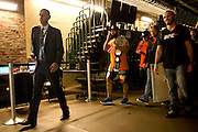 Johny Hendricks is escorted to the interview room after winning the UFC Welterweight Championship belt at UFC 171 in Dallas, Texas on March 15, 2014.