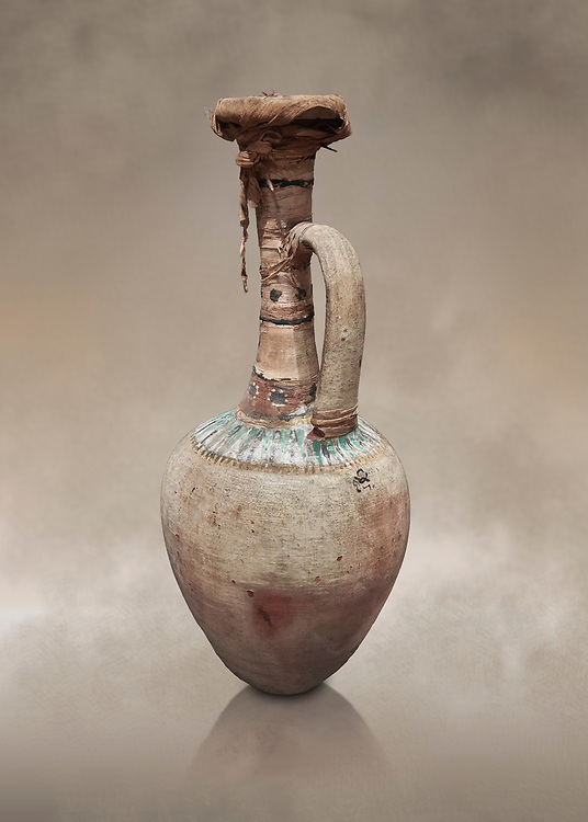 Ancient Egyptian glong neckedr jar  sealed with linen strips , tomb of Kha, Theban Tomb 8 , mid-18th dynasty (1550 to 1292 BC), Turin Egyptian Museum. Cat 8465.<br /> <br /> TT8 or Theban Tomb 8 was the tomb of Kha, the overseer of works from Deir el-Medina in the mid-18th dynasty[2] and his wife, Merit. TT8 was one of the greatest archaeological discoveries of ancient Egypt, one of few tombs of nobility to survive intact. .<br /> <br /> If you prefer to buy from our ALAMY PHOTO LIBRARY  Collection visit : https://www.alamy.com/portfolio/paul-williams-funkystock/ancient-egyptian-art-artefacts.html  . Type -   Turin   - into the LOWER SEARCH WITHIN GALLERY box. Refine search by adding background colour, subject etc<br /> <br /> Visit our ANCIENT WORLD PHOTO COLLECTIONS for more photos to download or buy as wall art prints https://funkystock.photoshelter.com/gallery-collection/Ancient-World-Art-Antiquities-Historic-Sites-Pictures-Images-of/C00006u26yqSkDOM