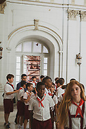 Cuban students on a school field trip enter the Museum of the Revolution (Museo de la Revolución). The building, inaugurated in 1920, had served as the Presidential Palace until the Cuban Revolution. (December 4, 2014)