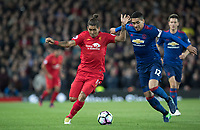 Football - 2016 / 2017 Premier League - Liverpool vs. Manchester United<br /> <br /> Liverpool's Roberto Firmino holds off Manchester United's Chris Smalling during the match at Anfield.<br /> <br /> COLORSPORT