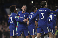 Danny Drinkwater of Chelsea (2nd left) celebrates with teammate  Willian (l) after Willian scores a penalty goal . Premier league match, Chelsea v Stoke city at Stamford Bridge in London on Saturday 30th December 2017.<br /> pic by Kieran Clarke, Andrew Orchard sports photography.