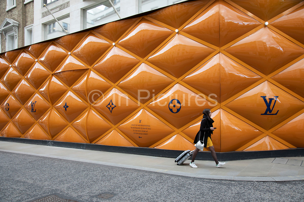 Louis Vuitton exclusive shop under refurbishment on Bond Street in London, United Kingdom.  It is one of the principal streets in the West End shopping district and is more upmarket. It has been a fashionable shopping street since the 18th century. Technically Bond Street does not exist: The southern section is known as Old Bond Street, and the northern section, which is rather more than half the total length, is known as New Bond Street. The rich and wealthy shop here mostly for high end fashion and jewellery.