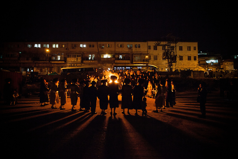 Ulra Orthodox Jews sing and dance around a bonfire, at Jerusalem's neighborhood of Mea Shearim.<br /> Lag BaOmer, is a Jewish holiday celebrated on the 33rd day of the Counting of the Omer, which occurs on the 18th day of the Hebrew month of Iyar.The motive for the commemoration of this day are unclear, they vary between celebration of Rabbi SHIMON BAR YOCHAI's revelations of the Kabbalah, another on is a period of success in the rebellion of the Jews against the Romans in the 2nd century and the last one is an end of a plague during that same period of time.