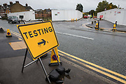 A sign indicates the entrance to the Montem Lane COVID-19 drive-in testing centre run by Serco on behalf of the Department of Health and Social Care on 4 October 2020 in Slough, United Kingdom. Slough Borough Council confirmed on 2nd October that its coronavirus infection rate is the highest in the south of England and Slough MP Tan Dhesi asked Health Secretary Matt Hancock in Parliament whether the Montem Lane test centre could be reverted to permit walk-in and drive-in visits without an appointment.