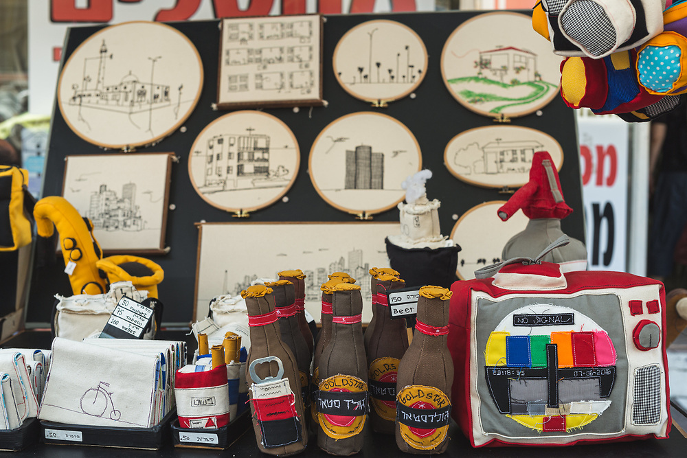 Souvenirs on display at a stall in Nachalat Binymain Arts and Crafts Market in Tel Aviv