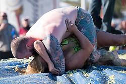Custom bike builder Joe Lingley of Maine jumped in the pit with Heather Spears for the grand finale of the annual cole slaw wrestling competition at the Cabbage Patch during Daytona Bike Week. (Joe is reported to be the first male to wrestle in the slaw.) New Smyrna Beach, FL. USA. Wednesday March 15, 2017. Photography ©2017 Michael Lichter.