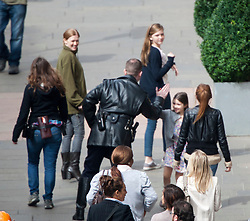 """Day two filming. Brad Pitt's co-star Mireille Enos with her movie family on the set of the movie """"World War Z"""" being shot in the city centre of Glasgow. The film, which is set in Philadelphia, is being shot in various parts of Glasgow, transforming it to shoot the post apocalyptic zombie film.."""