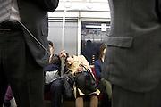 woman sleeping while commuting Japan