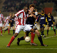 Photo: Richard Lane.<br /> Wimbledon v Stoke City. FA Cup 5th Round. 03/01/2004.<br /> Gifton Noel-Williams does battle with Dean Lewington.