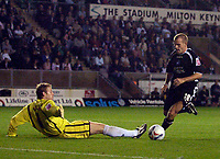 Photo: Alan Crowhurst.<br />MK Dons v Swansea. Coca Cola League 1.<br />13/09/2005. Andy Robinson of Swansea rounds keeper Matt Baker to score his first goal.