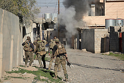 Licensed to London News Pictures. 20/02/2017. Albu Saif, Iraq. An Iraqi Emergency Response Division team react to an explosion as they clear the village of Albu Saif during the offensive to retake western Mosul from Islamic State militants.<br /> <br /> The settlement of Albu Saif is located on high ground overlooking Mosul Airport and as such is a strategic point that needs to be taken as part of the operation to retake the western side of Mosul. Photo credit: Matt Cetti-Roberts/LNP