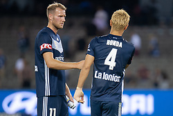 February 23, 2019 - Melbourne, VIC, U.S. - MELBOURNE, VIC - FEBRUARY 23: Melbourne Victory forward Ola Toivonen (11) shakes Melbourne Victory midfielder Keisuke Honda (4) hand after the match at round 20 of the Hyundai A-League Soccer between Melbourne City FC and Melbourne Victory on February 23, 2019 at Marvel Stadium, VIC. (Photo by Speed Media/Icon Sportswire) (Credit Image: © Speed Media/Icon SMI via ZUMA Press)