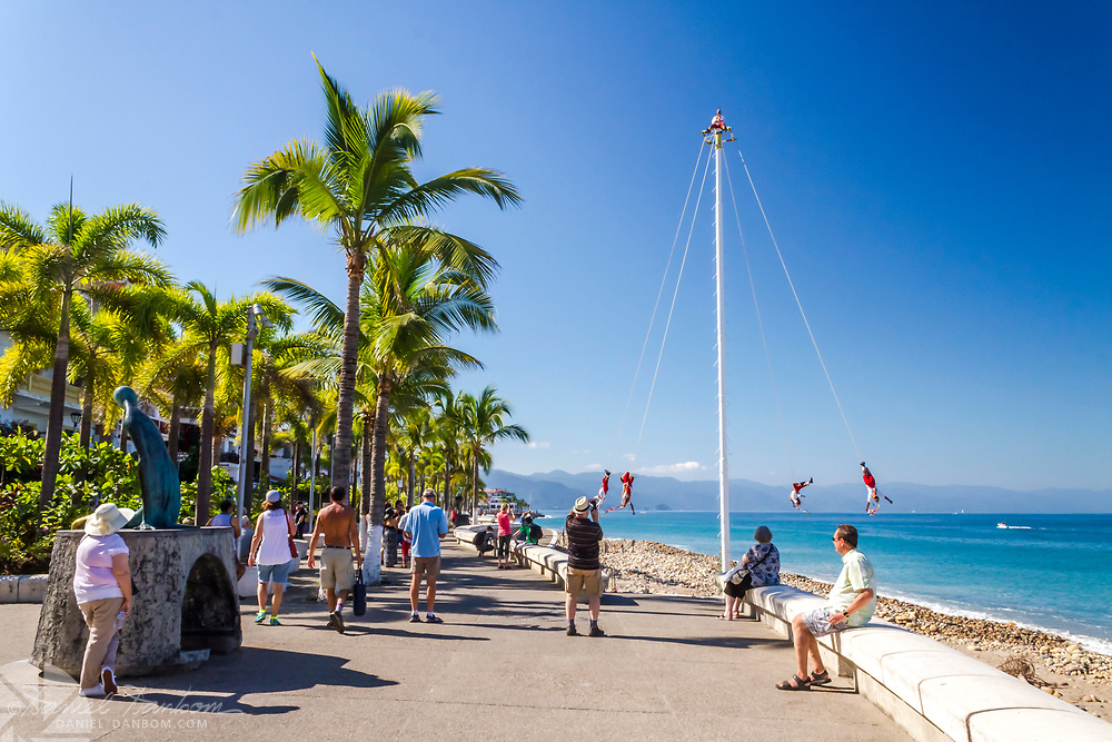 Paseo Daiz Ordaz, Puerto Vallarta, Mexico, shoreline esplande, with native performers with a tall pole and ropes.