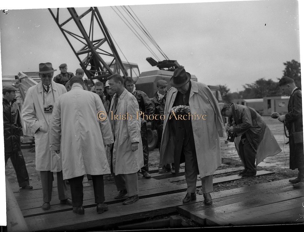 03/08/1962<br /> 08/03/1962<br /> 03 August 1962<br /> Oil representatives at Rathmolyon, Co. Meath. Mr F. Kirk Johnston, Chairman, Ambassador Oil Corporation, and President Ambassador Irish Oil Co. takes a souveinir picture at the  site of the 1st Oil Drilling at Rathmoylon. Included is Mr James Stewart, Film Star and Ambassador Shareholder.