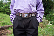 A picture of Barak Obama, the President of the United States, on a man's belt buckle in the village of Buhoma, Uganda.