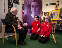 Edinburgh's Bailie Elaine Aitken opened Firrhill High School's 'The Anne Frank: A History For Today' exhibition  today. Baillie Aitken was joined by Heather Boyce from the Anne Frank Trust and second generation Holocaust survivors who spoke of their family members' memories of the war. The ceremony was attended by pupils from Firrhill High, local primary schools and retirement home residents from Old Farm Court and Caiystane Court. Emily Mitchell and Alisha Laing (both 12) from Longstone Primary presented Mr Brent with a small bouquet of thanks for his time.  29 April 2014 (c) GER HARLEY | StockPix.eu